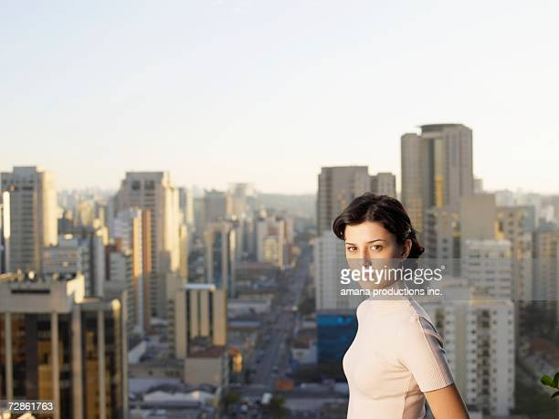 Young woman, city in background (portrait), Sao Paolo, Brazil