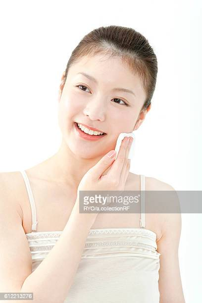 Young Woman Cleaning Face