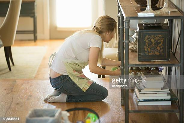 young woman cleaning home with green cleaning products - heshphoto bildbanksfoton och bilder