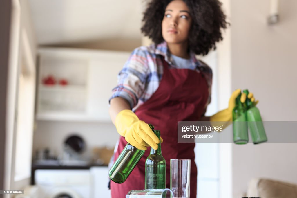 Young Woman Cleaning Kitchen : Stock Photo