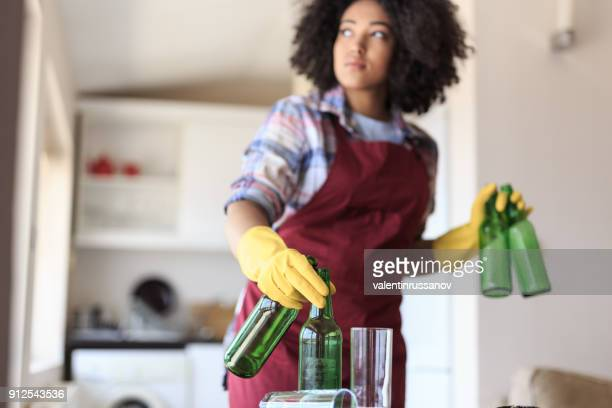 young woman cleaning kitchen - cleaning after party stock pictures, royalty-free photos & images