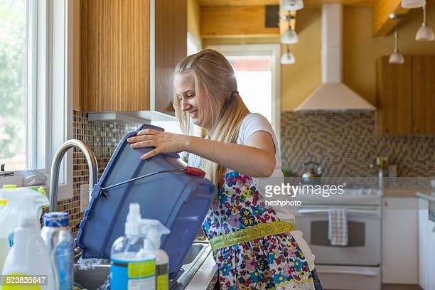 young woman cleaning kitchen with green cleaning products - heshphoto bildbanksfoton och bilder