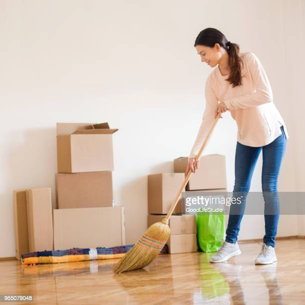 young woman cleaning - sweeping stock pictures, royalty-free photos & images