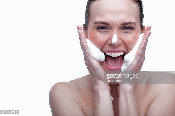 Young woman cleansing face