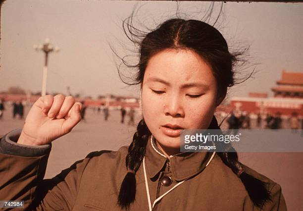 A young woman clenches her fist as a tear rolls down her cheek January 13 1976 in Tiananmen Square in Peking China She pays homage to the loss of...