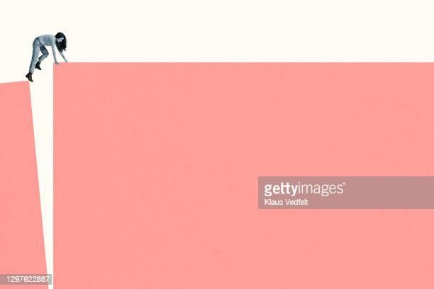 young woman climbing coral ramp - ジェンダー・ステレオタイプ ストックフォトと画像