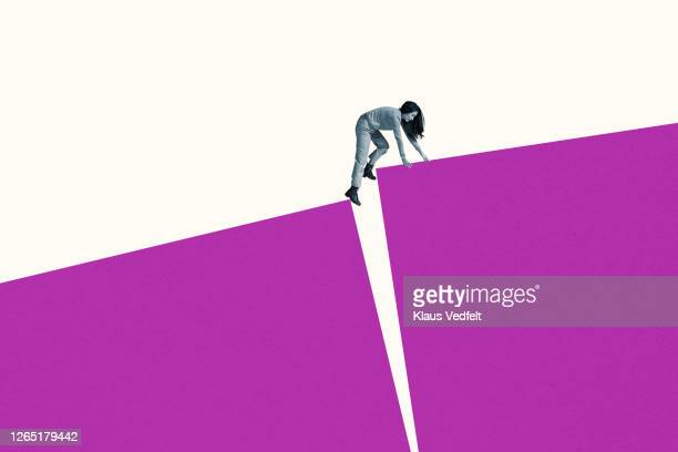 young woman climbing on large magenta blocks - separation stock pictures, royalty-free photos & images