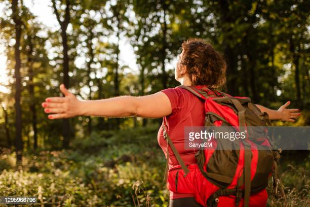young woman climbing the mountain - non urban scene stock pictures, royalty-free photos & images