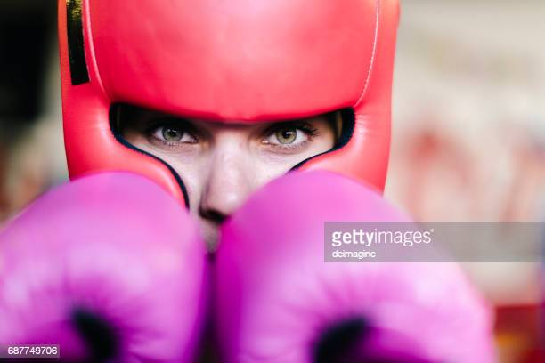young woman close up in boxer in ring - women's boxing stock pictures, royalty-free photos & images