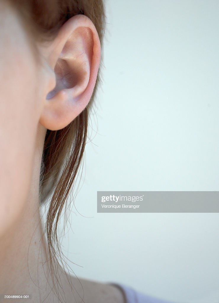 Young woman, close-up of ear : Stock Photo