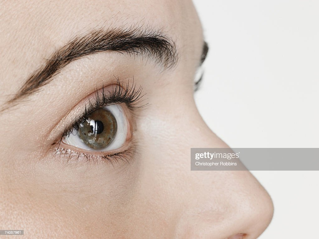 Young woman, close-up of eye, side view : Stock Photo