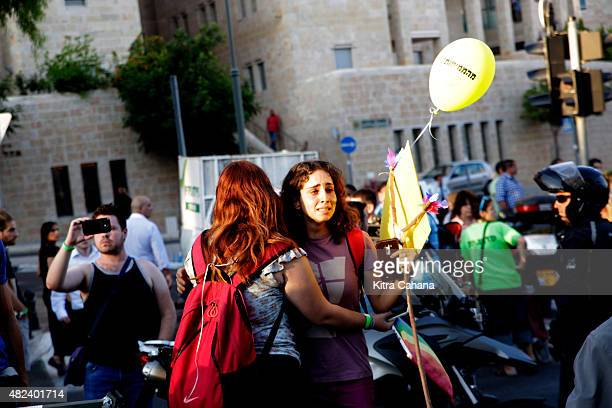 A young woman comforts her friend at the site of the Gay Pride Parade stabbing on July 30 2015 in downtown Jerusalem Israel At least six people were...
