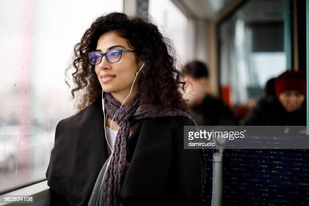 young woman commuting by public transport - riding stock pictures, royalty-free photos & images