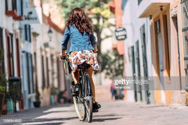 young woman commuting on bicycle - queretaro state stock pictures, royalty-free photos & images