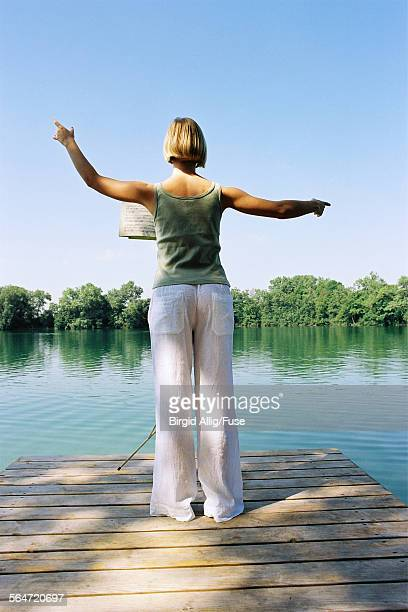 Young woman conducting at a lake
