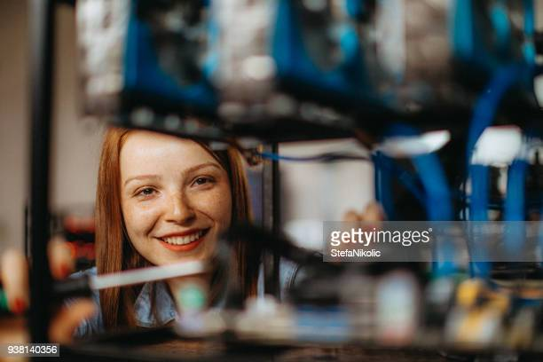 young woman configures computer for mining - financial technology stock photos and pictures