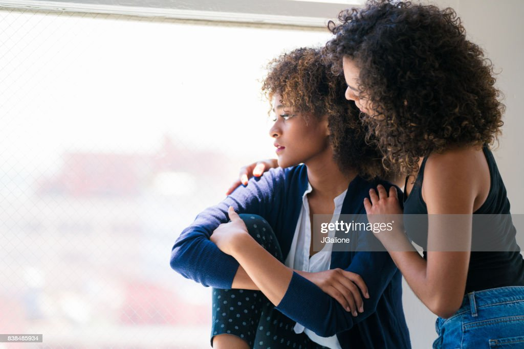 Young woman consoling her friend : Stock Photo