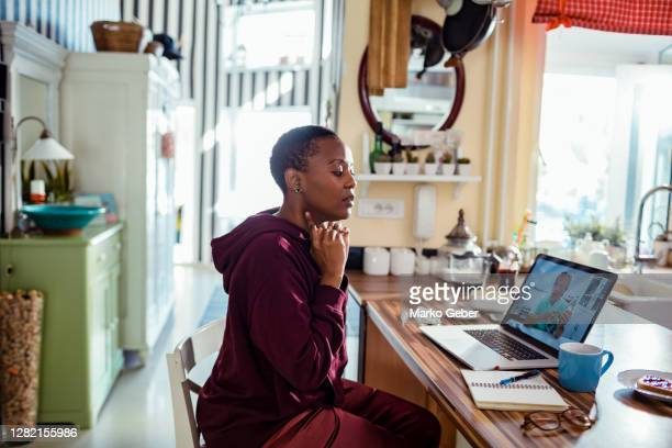 young woman consulting with her doctor online - healthcare stock pictures, royalty-free photos & images