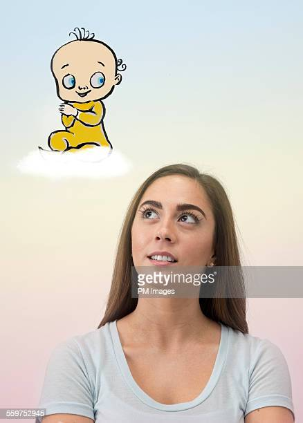 Young woman contemplating baby
