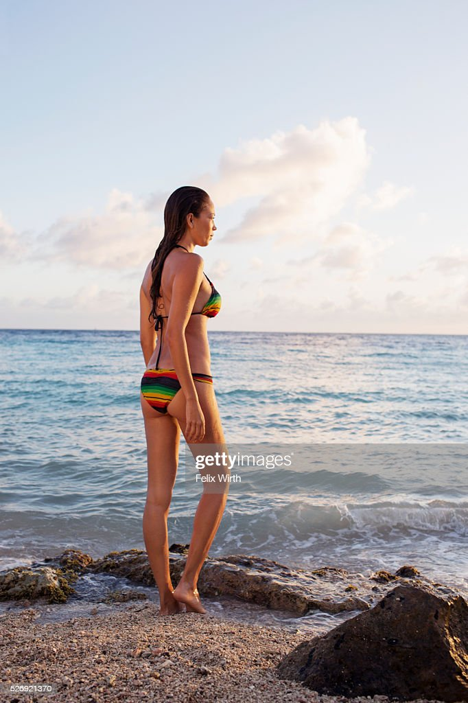 Young woman contemplating beautiful view on tropical beach : Stock Photo