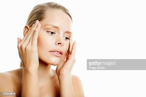 Young woman contemplating face lift