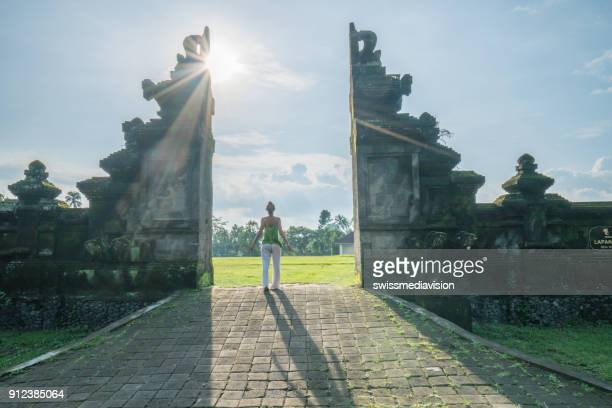 Young woman contemplating nature, Bali gate,Indonesia