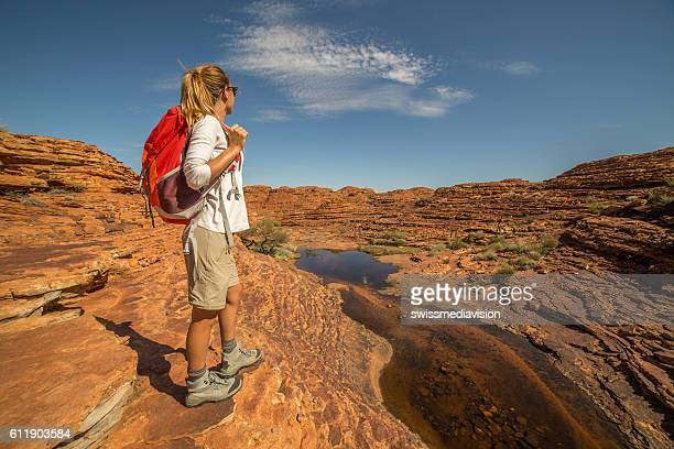 Young woman contemplating nature on hiking day