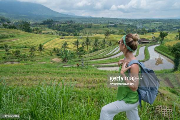 Young woman contemplating rice terrace, Ubud- Bali