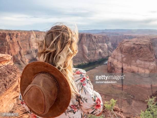 young woman contemplating the horseshoe bend in arizona, usa - arizona stock pictures, royalty-free photos & images