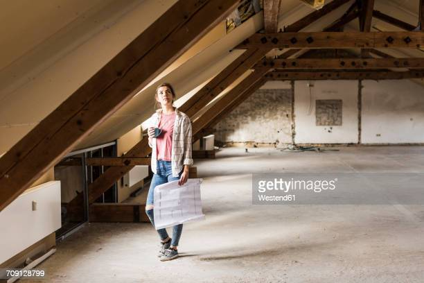 Young woman contemplating the renovation of her new home