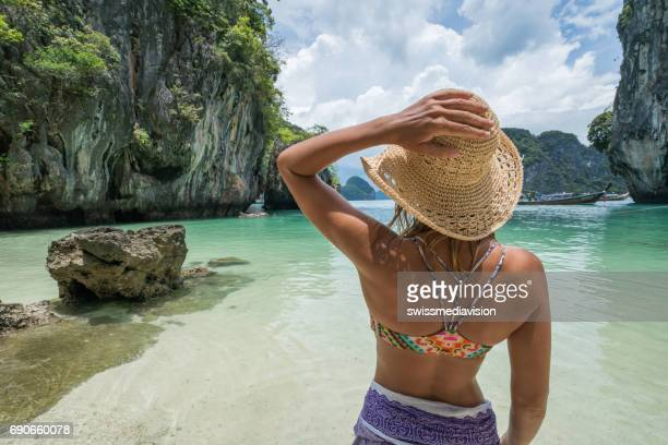 Young woman contemplating tropical beach