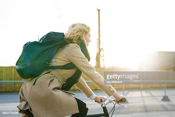 Young Woman Contemplating While Riding Bicycle In The Evening