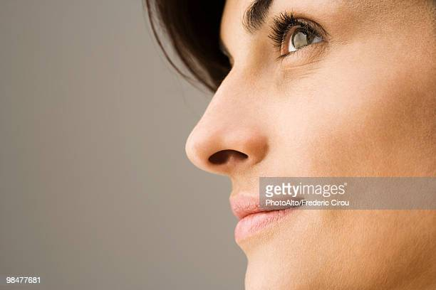 young woman contemplatively looking away, profile - part of stock pictures, royalty-free photos & images