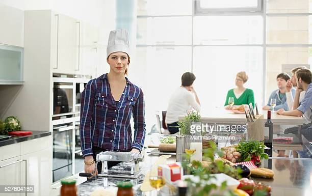 Young woman cooking in modern kitchen