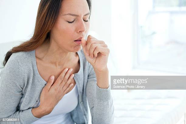 young woman coughing - cough stock photos and pictures
