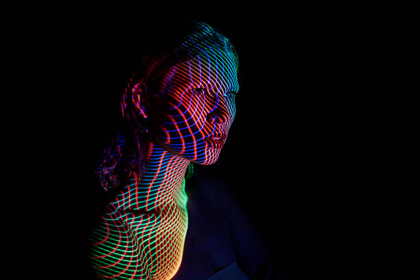 Young Woman Covered by futuristic Lines of Lights