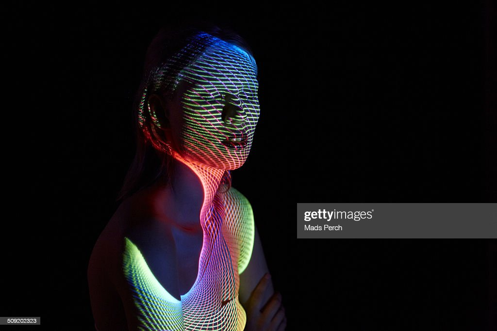 Young Woman Covered by Futuristic Lines : Stock Photo