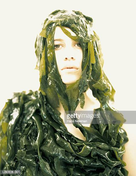 Young woman covered with kelp