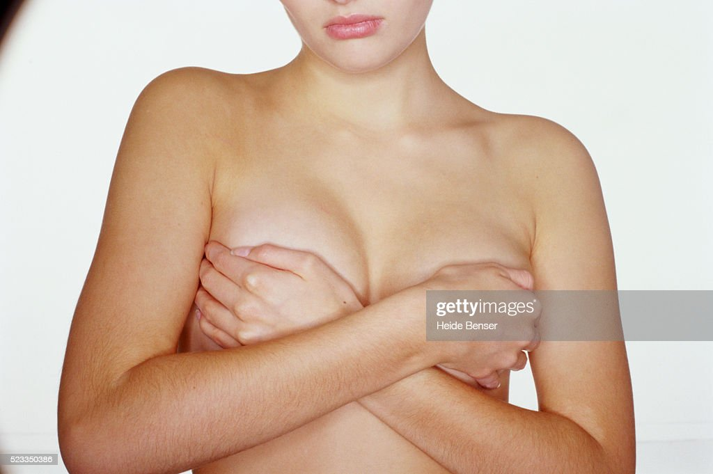 Young Woman Covering Breasts Stock Photo  Getty Images-3788