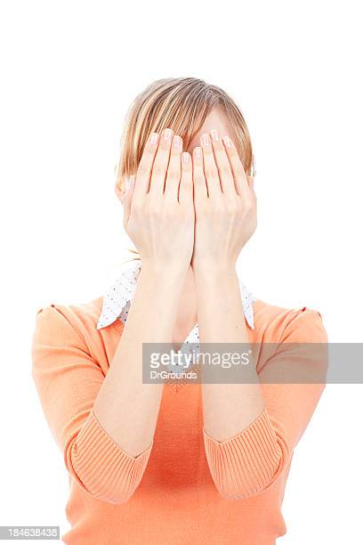 Young woman covering face with her arms
