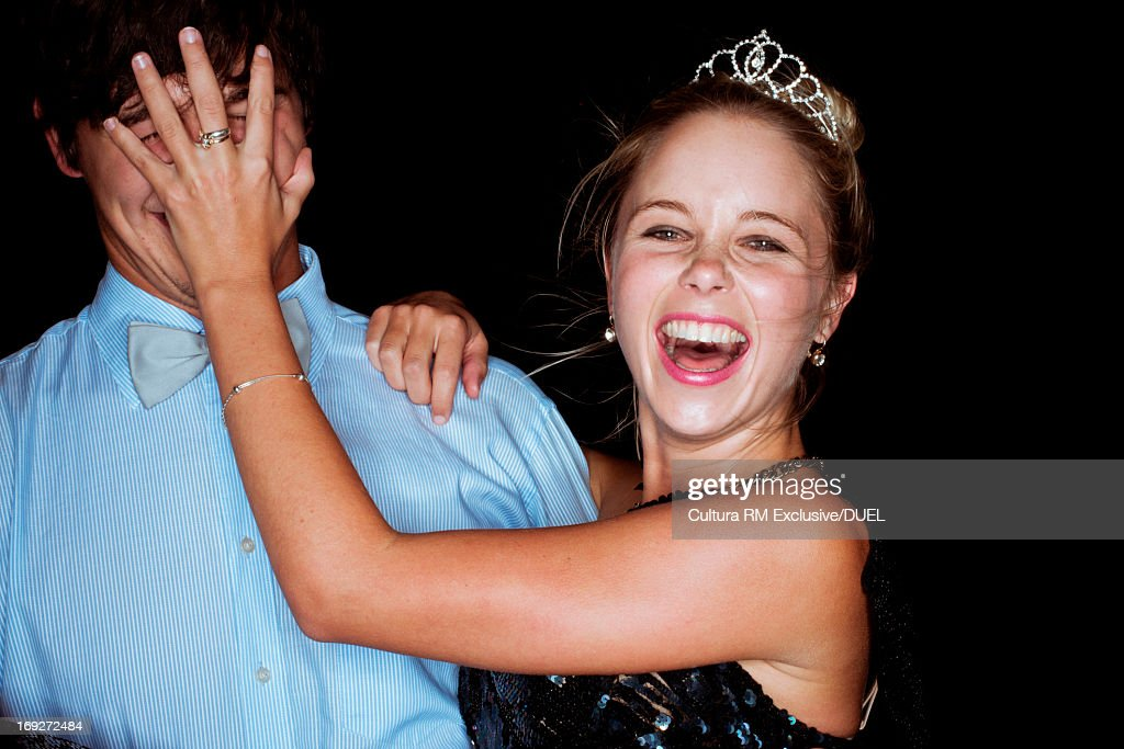 Young woman covering man's face at party : Stock Photo