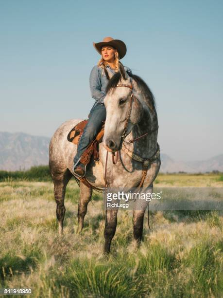 Young Woman Cowgirl With Her Horse