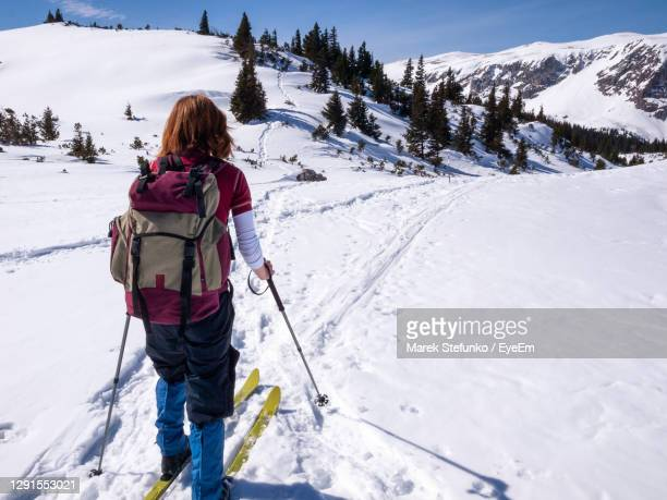 young woman cross-country skiing in raxalpe mountains, austria - marek stefunko stock pictures, royalty-free photos & images