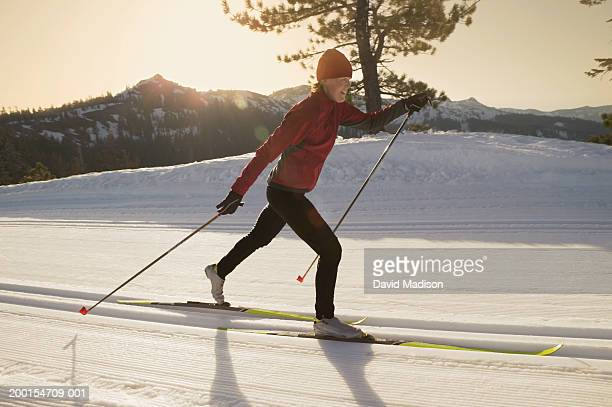 Young woman cross-country skiing, profile
