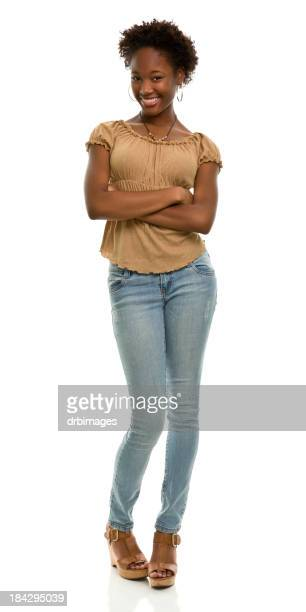 young woman crossing arms in full length portrait - beautiful black teen girl stock photos and pictures