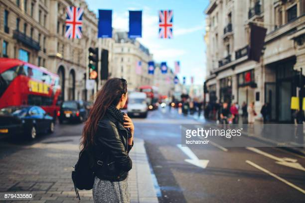 Young woman crossing the street in Central London