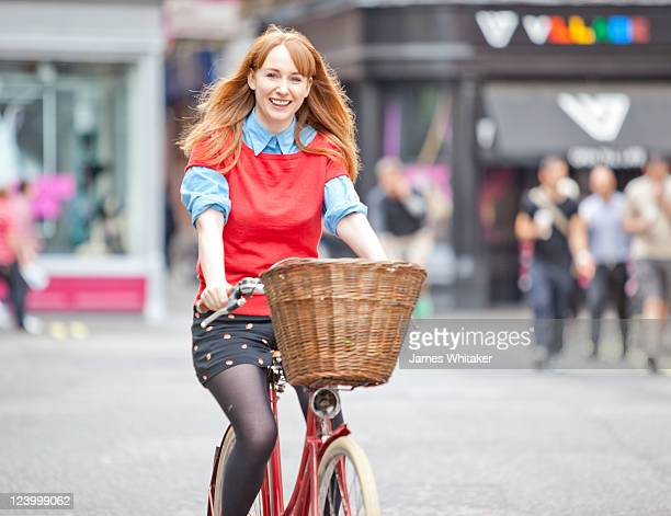 Young Woman cycles through town