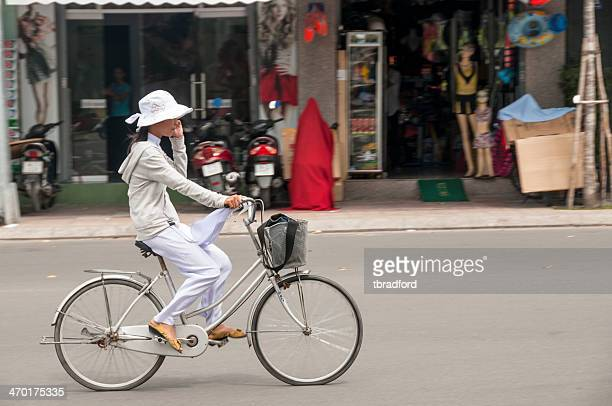 Young Woman Cycling In Nha Trang, Vietnam