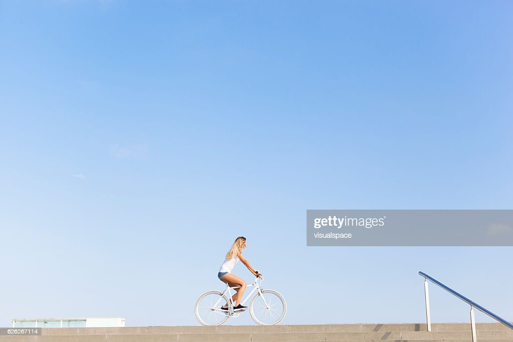Young Woman Cycling in the City : Stock Photo