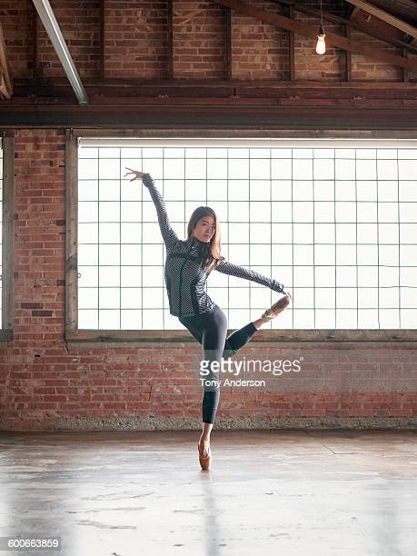 Young woman dancer practicing in rehersal studio